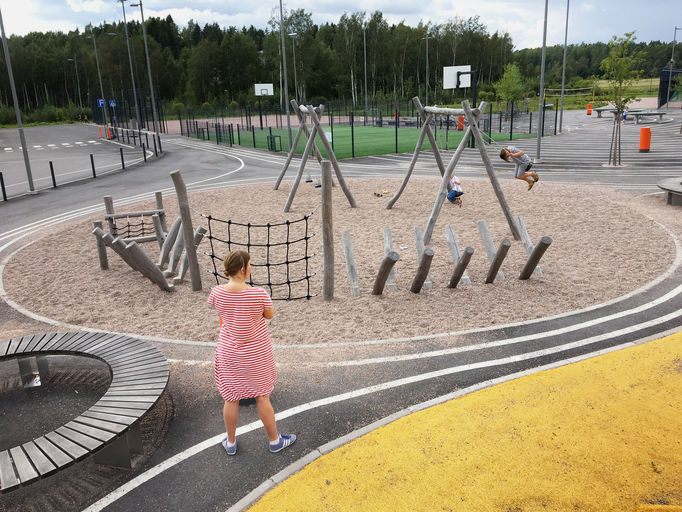 playground with pavement, sand and wood