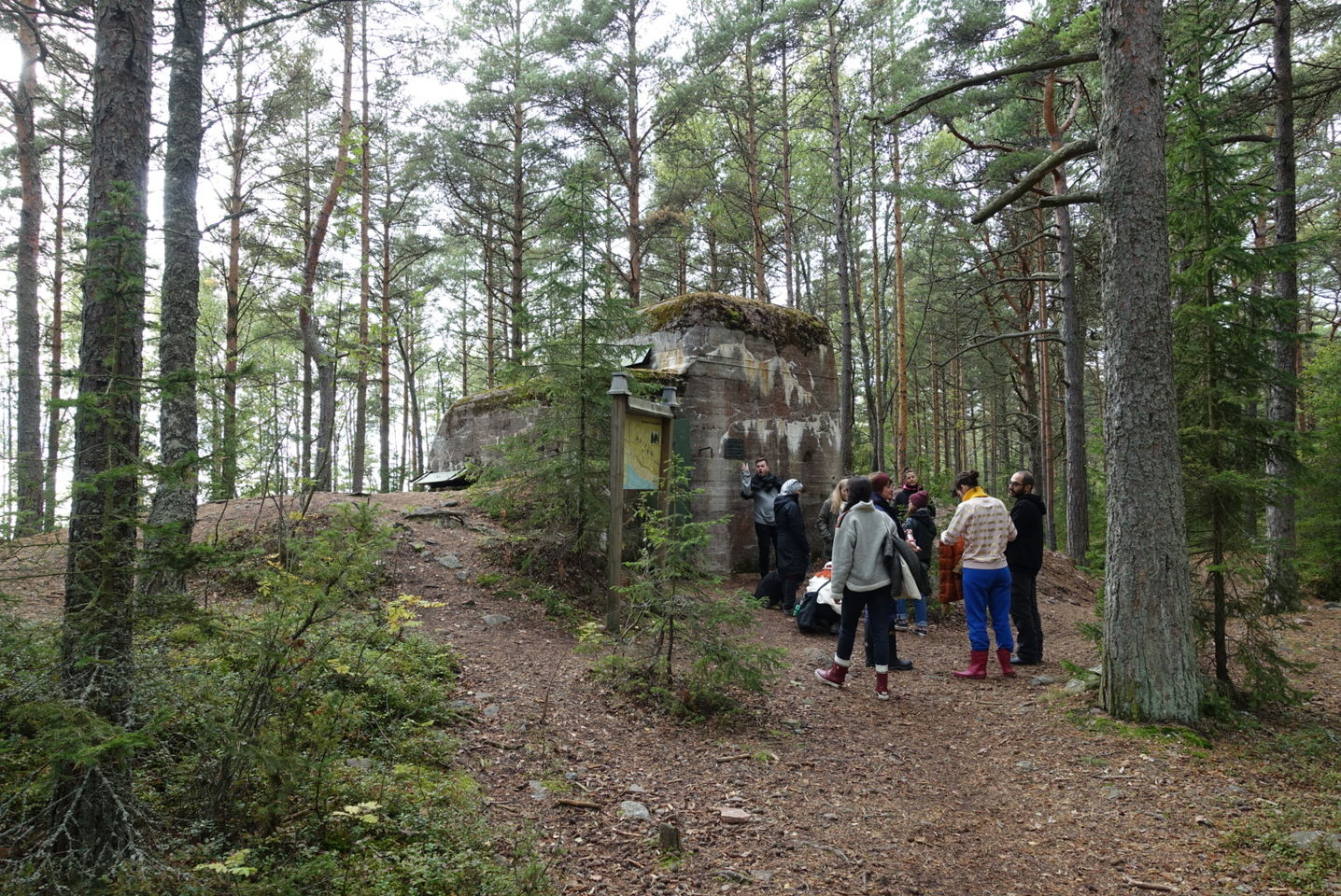 Students gather outside an old military bunker, in the middle of a forest, on the island of Reposaari